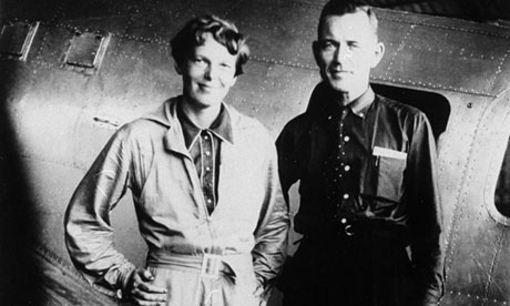 Amelia Earhart and Fred Noonan, her navigator, in front of their twin-engine Lockheed Electra in May