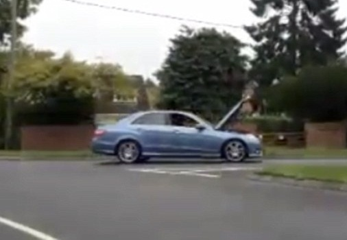 Motorist Caught Driving With Hood Up