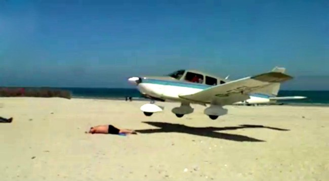 Pilot landed accidentally this plane in the back of sunbather