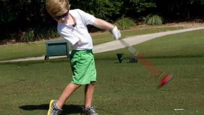A three year old golfer can drive a ball 100 yards using just one hand