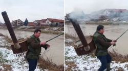 Fisherman carries a stove on his back to fight with the cold during fishing