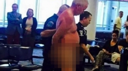 Man was taken by security guards after stripping naked at airport