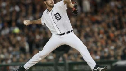 Frazier's grand slam lifts Reds over Tigers in extra innings