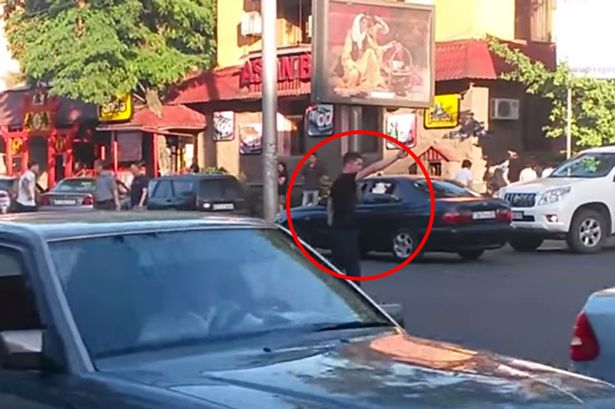 Hero pedestrian manages to keep everyone moving during a 'traffic light break' in busy city