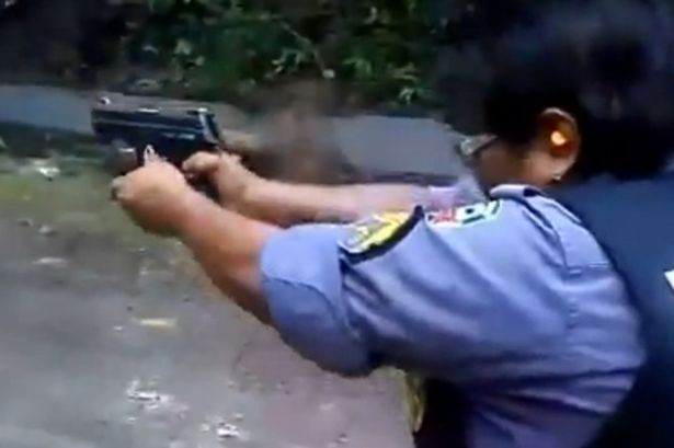 Policewoman tries to fire a gun but instead gets hit on her own face