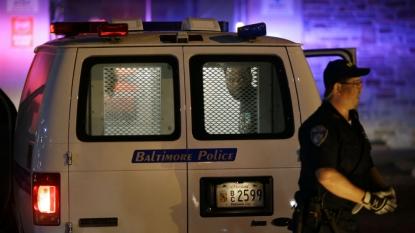 Baltimore police probe transport van sign