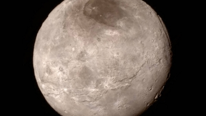 Crater-less Pluto's icy peaks high as Rockies, Charon's canyons deeper than