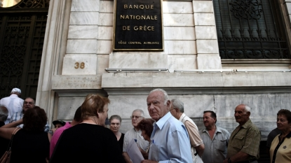 "Greek bank official says deposit haircut report ""baseless"""