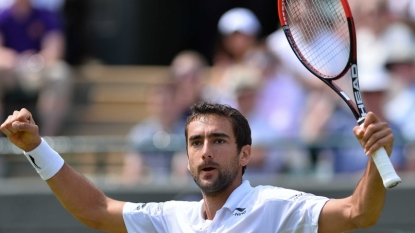 Play suspended between marathon men Cilic and Isner