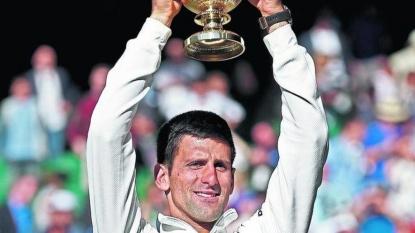 Novak Djokovic toys with Bernard Tomic on Centre Court at Wimbledon
