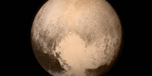 NASA Names Craterless Plain on Pluto After Tombaugh