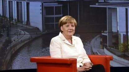 Refugee defends Merkel's reaction during tearful encounter