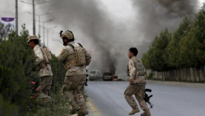 Taliban bomber, gunmen attack Afghan parliament