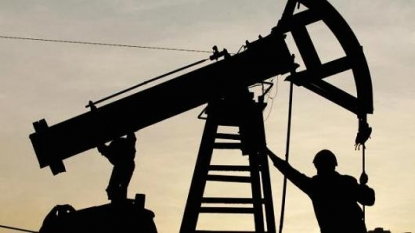 U.S. crude falls more than 1 pct on surprise stockpile build