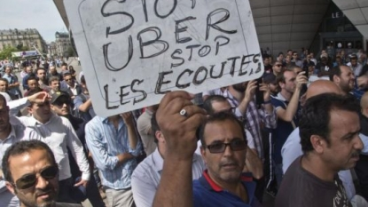Uber suspends lowest-cost service in France after managers charged, Uber