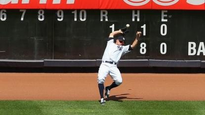 Baseball fan throws homerun ball back onto field, hitting Yankees outfielder