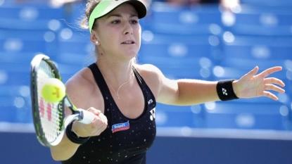 Belinda Bencic's winning streak ends while Serena Williams cruises through
