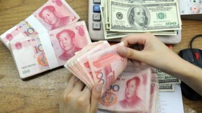 China fixes yuan stronger vs dollar, reversing falls