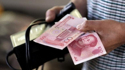 China's Currency Move Could Fuel These Five Billionaire-Owned Chinese Stocks