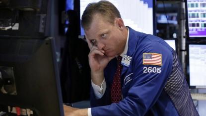 China stocks slip amid global market weakness, concerns over China's economy