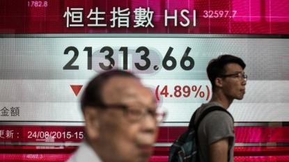 Hong Kong, Shanghai stocks tumble in early trade