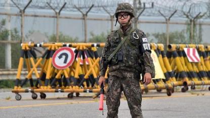 The Latest on Koreas: S. Korean leader visits border base