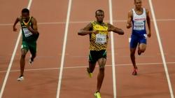 Usain Bolt tripped by cameraman after winning 200m gold