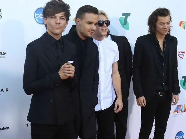 One Direction members confirm 'well earned break'