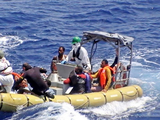 Sinking migrant boat poses desperate choices for father