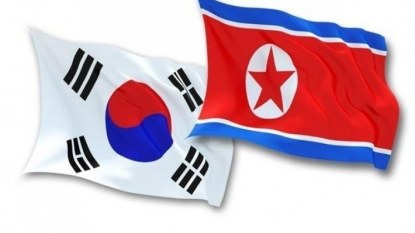 Two Koreas reach middle ground in wage row