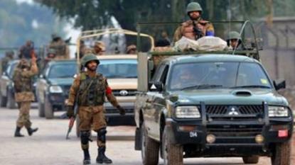Taliban militants kill at least 20 at Pakistani military base, mosque