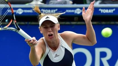 Battling Johanna Konta beaten by Venus Williams in Wuhan Open