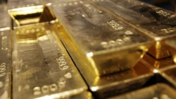 Gold slips to near six-year low