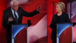 In contentious debate, Clinton and Sanders both claim 'progressive' mantle