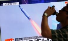 North Korea's Kim praises submarine launch test as a success