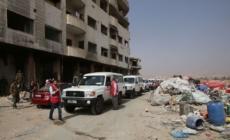 First evacuees leave besieged Damascus suburb Daraya