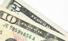 Greenback slips as market discounts U.S. rate hike